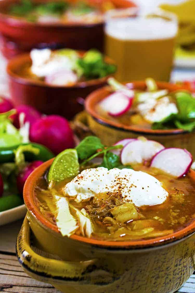 Posole is a traditional Mexican pork stew made with chili sauce.
