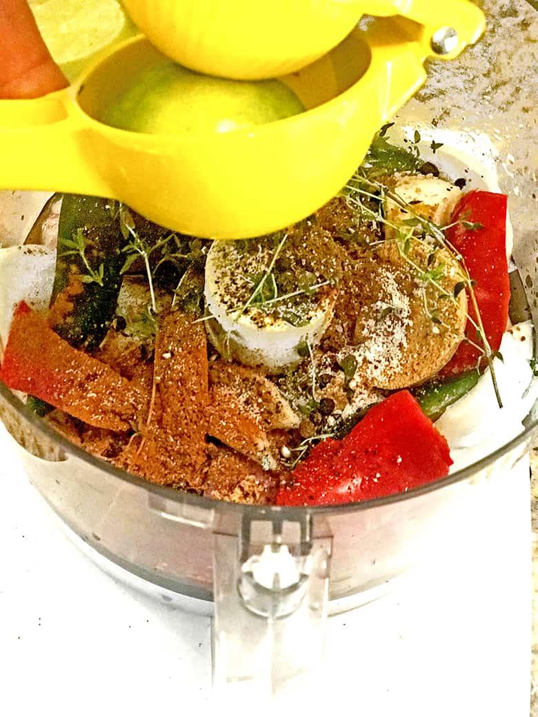 Combining marinade ingredients for jerk chicken.