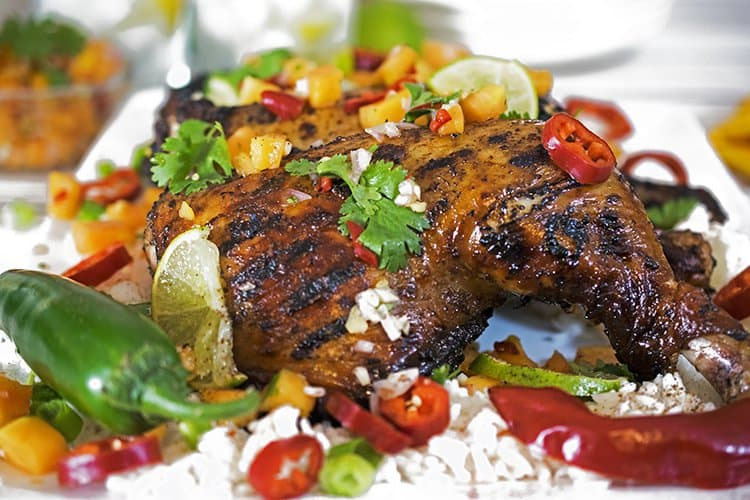 Serve this jerk chicken with white rice and papaya salsa.
