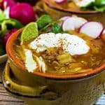 Sour cream and lime wedges add extra flavor to this posole recipe.