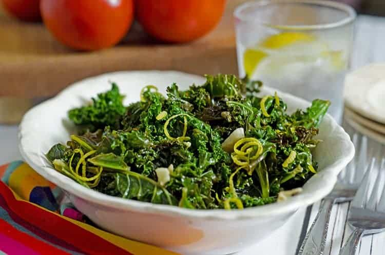 This steamed kale recipe for platter talk food blog features fresh lemon juice and zest, garlic, and crushed red pepper.