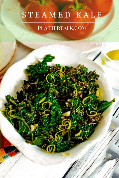 Bowl of steaed kale with lemon zest garnish.