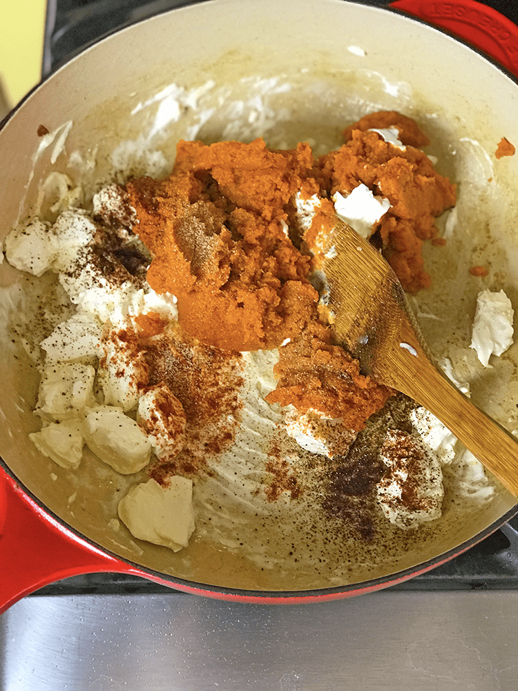 Making a pumking gnocchi sauce with pumpkin puree and