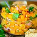 Bowl of papaya salsa with chips.