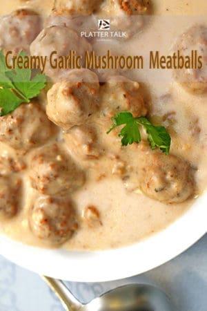 Bowl of mushroom meatballs with parsley garnish.