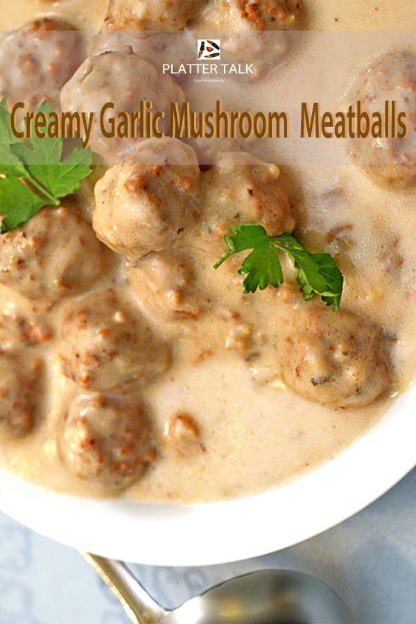 Bowl of mushroom meatballs with parsley garnish.