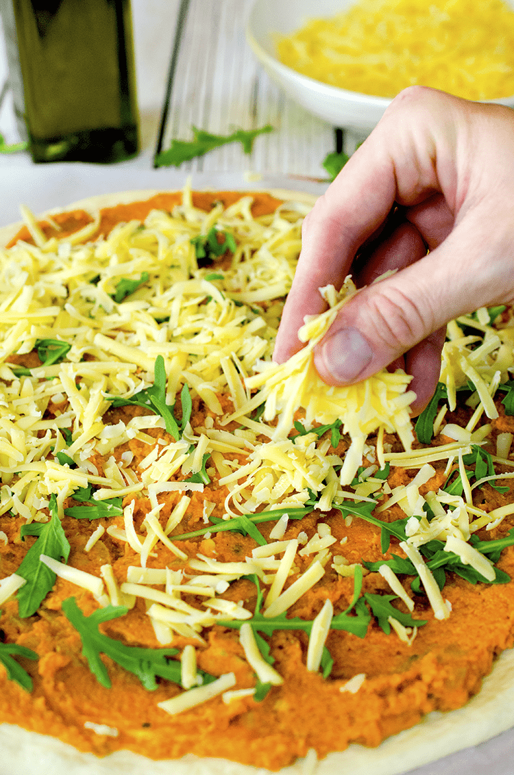 We like to use savory Gouda cheese on our pumpkin pizzas.