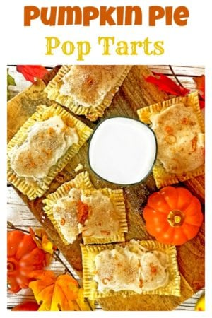 A close up pumpkins, pop tarts and glass of milk