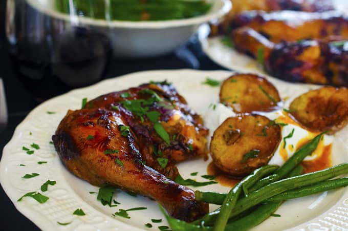 Enjoy a delicious serving of slow cooker chicken thighs with green beans and roasted potatoes.