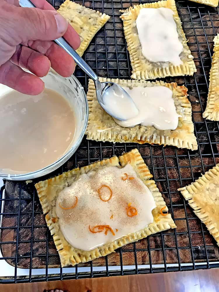 Use a spoon to apply icing to each pop tart.
