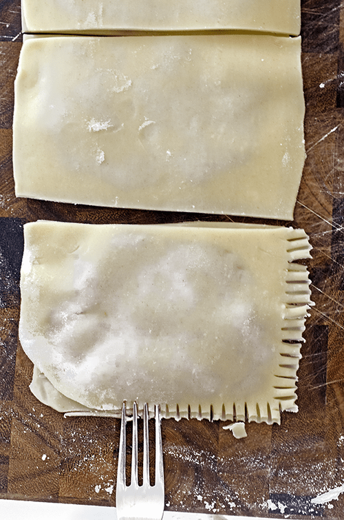 Use a fork to crimp the edges of pop tarts.