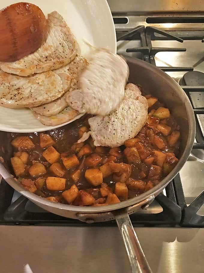 Cooked pork added to pan of cooked apples and sauce