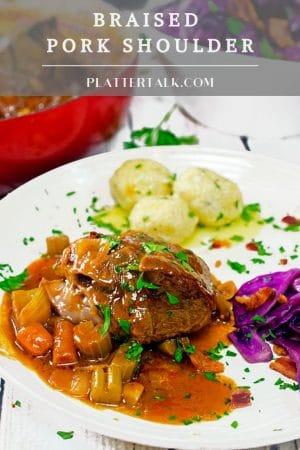 Plate of braised pork with potato dumplings.