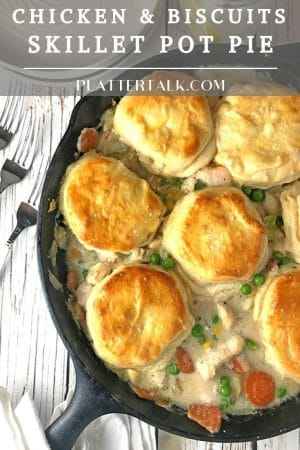 Cast iron skillet holding chicken & bisucits pot pie.