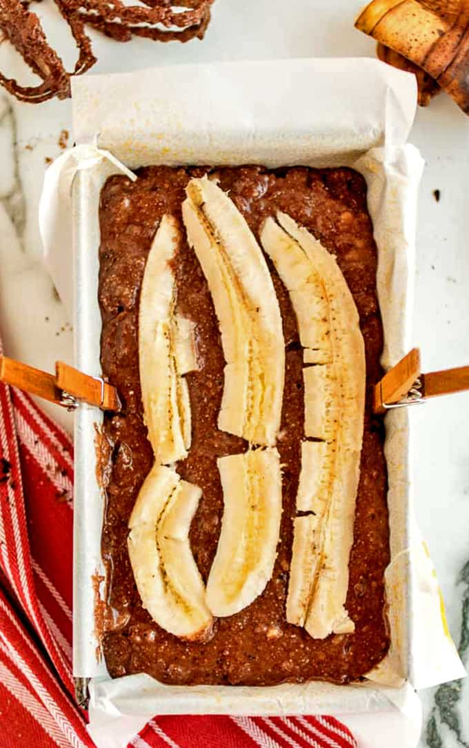 Top this chocolate banana bread with a sliced banana.