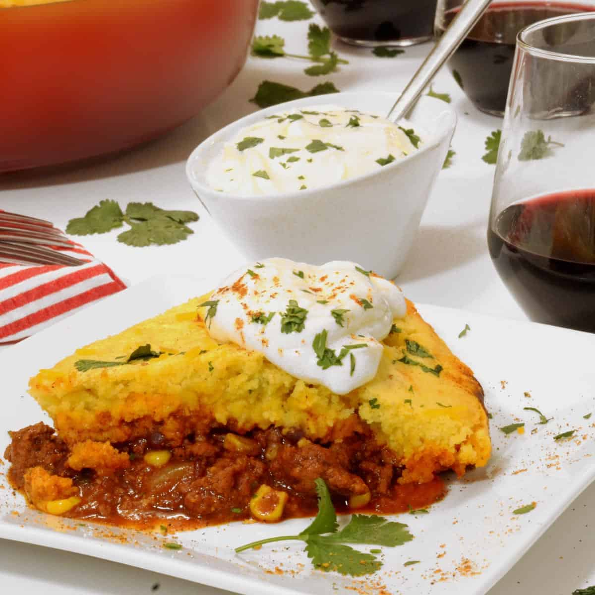 A slice of chili cornbread casserole on a plate.