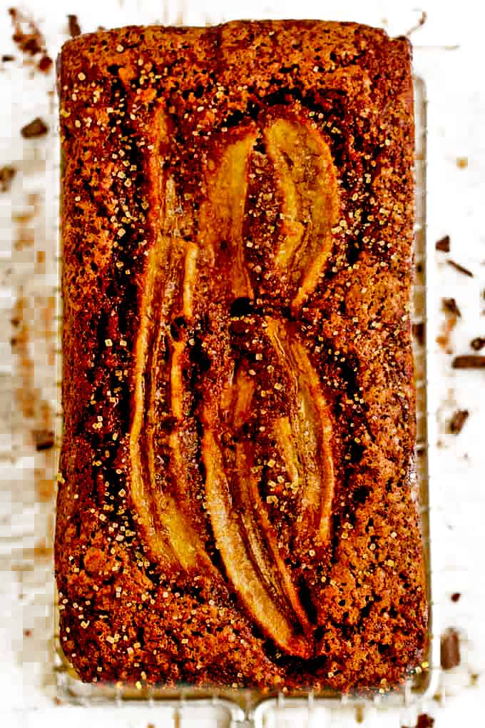Slices of banana are baked on top of chcolate banana cake.