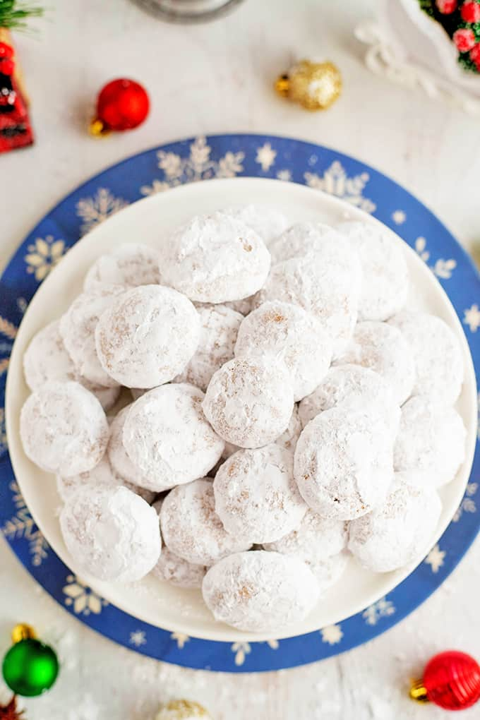 Pfeffernuse cookies are rolled in powdered sugar.