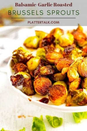 Serving plate of roasted brussels sprouts made with balsamic vinegar and garlic.