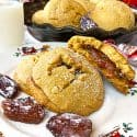 A plate of date-filled cookies with date garnishes.