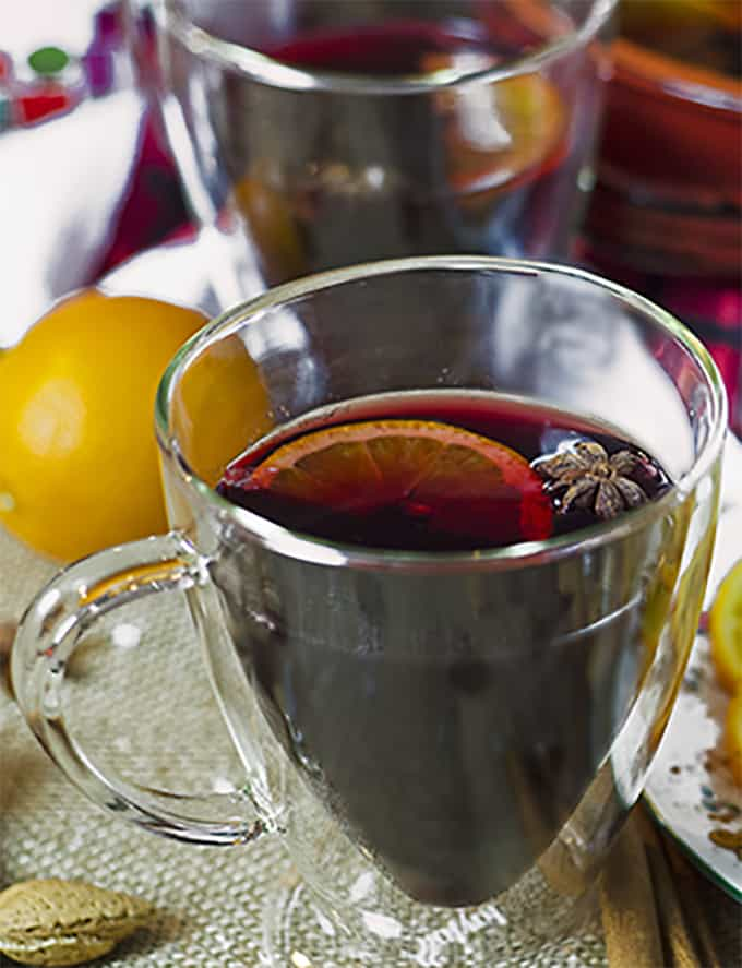 A glass of mulled sangria with fruit