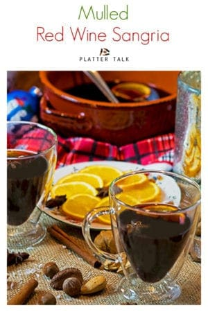 Mulled red wine sangria from Platter Talk can be made on the stovetop or in a slow cooker. Make this hug in a mug in for this holiday season and enjoy it all winter long! #recipe #slowcooker#spices #Christmasmarkets #applecider #holidayparties #winter #cinnamon