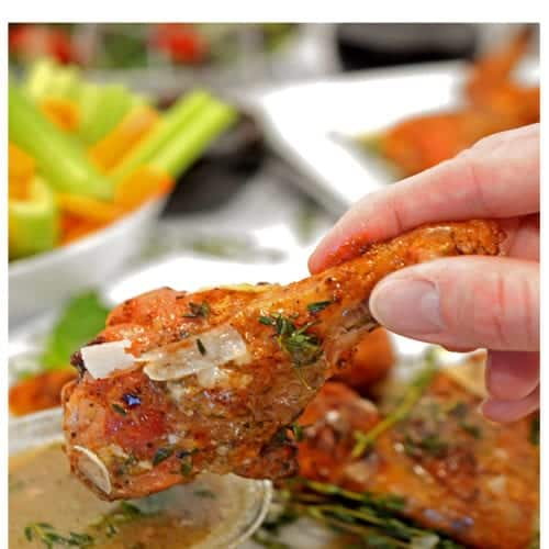 Dipping 3-ingredient chicken wing into sauce.