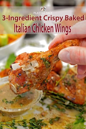 dipping an Italian chicken wing in sauce.