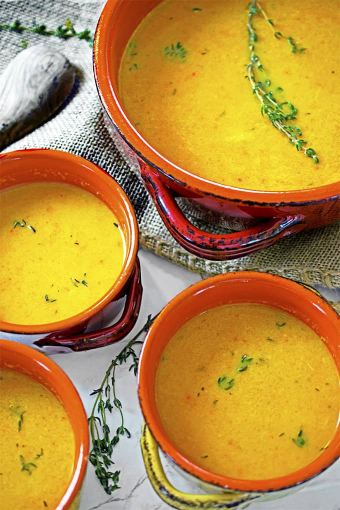 Four bowls of roasted butternut squash soup.