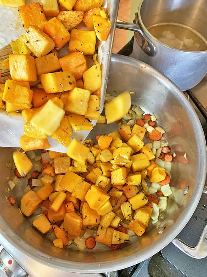 Adding roasted butterrnut squash to a mirepoix.