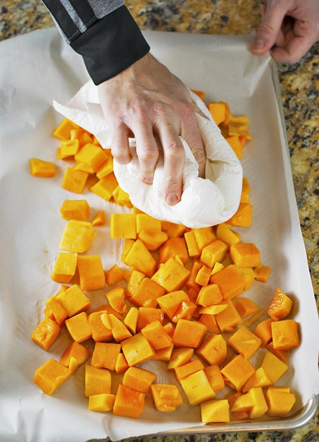 Use a paper towel to blot dry the butternut squash before roasting it.