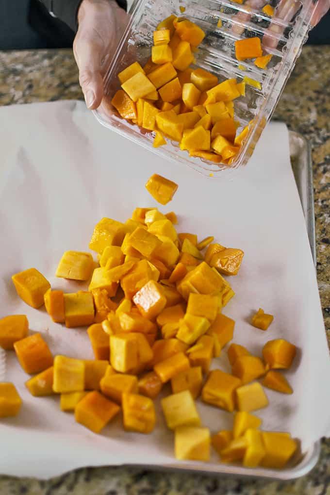 Cubes of butternut squash on a cutting board