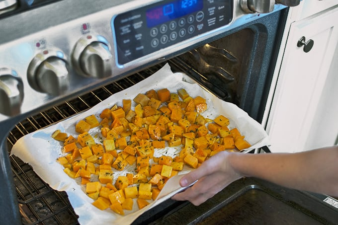 Food cooking in an oven, with Butternut squash