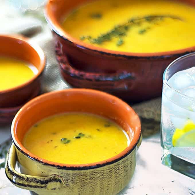Three bowls of roasted butternut squash soup.