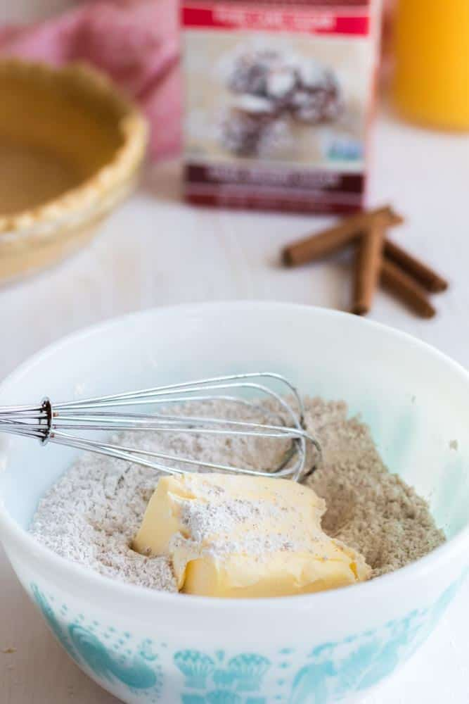 Adding cold butter to crumb topping.