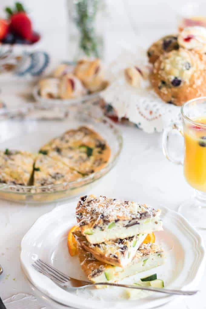 crustless zucchini quiche with muffins and juice.