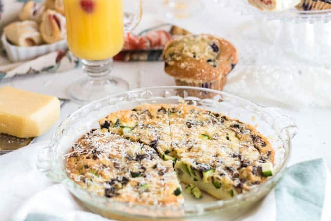 Crustless zucchini quiche with muffin and juice.