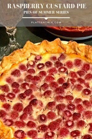 Raspberry custard pie, homemade, with glass of white wine.