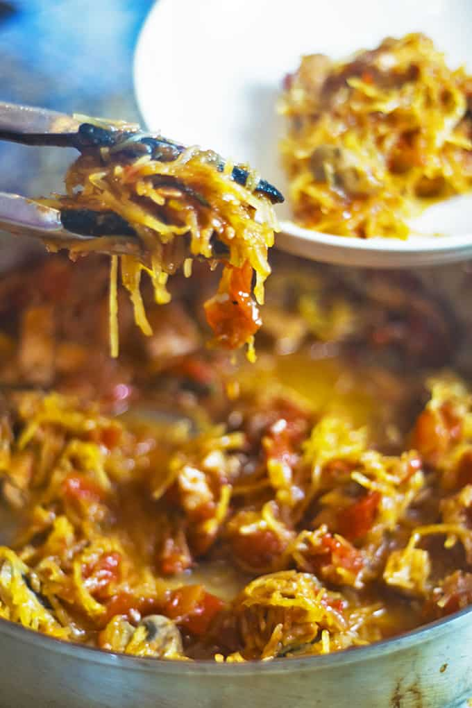 A dish is filled with food, with spaghetti squash