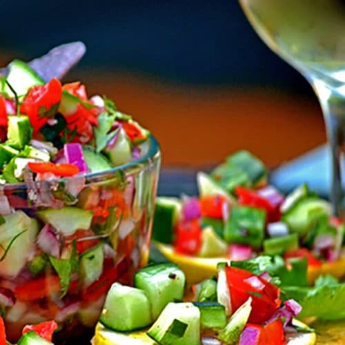 Cucumber salsa with glass of white wine.