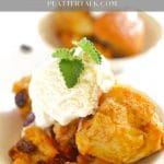 Bowl of crock pot bread pudding with vanilla icre cream and mint leaf.