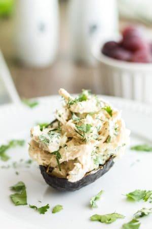 Servig of keto chicken salad in an avocado.