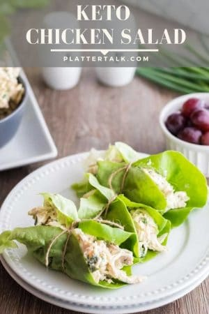 Three lettuce wraps with keto chicken salad on white plate.
