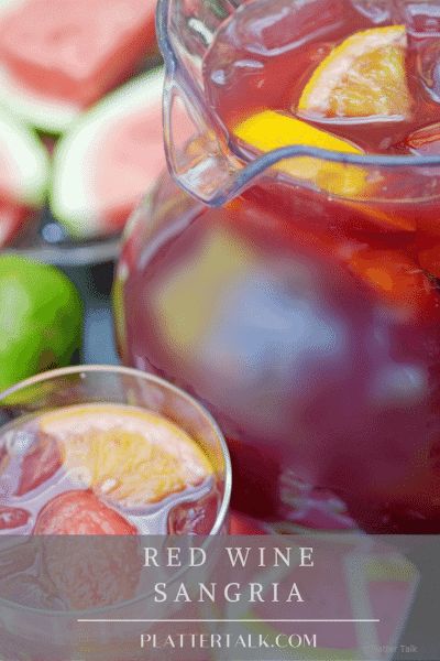 Pitcher of red wine sangria with vodka and a glass of red snagria.
