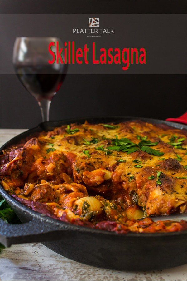 skilledt lasagna with glass of red wine.