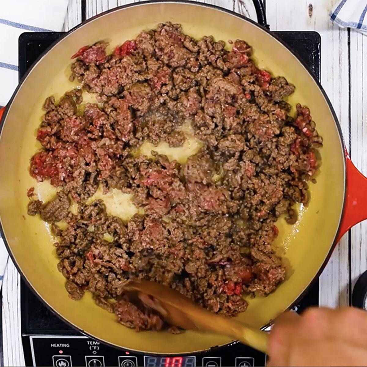 Browing ground beef in a skillet.