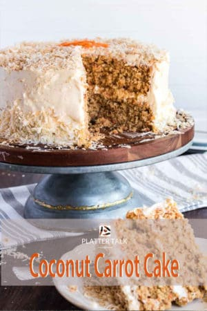 Slice of coconut carrot cake with full cake in background.