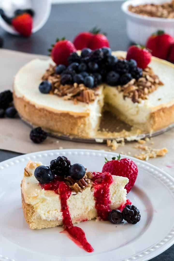 Keto New York Cheesecake with fresh berry compotoe on a plate.
