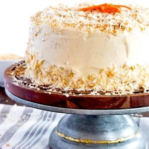 Frosted carrot cake on a pedestal