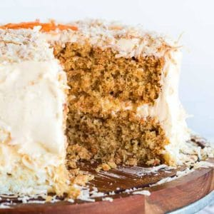 Carrot Cake with wedge cut out.